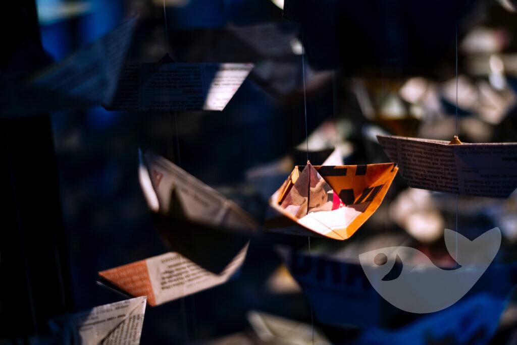 Papierschiffe: Illustration und Windspiel